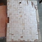 One of the wooden boards inlaid with cubes of ivory
