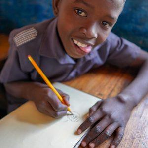 Boy drawing in classroom